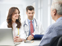 Medical team with elderly patient Royalty Free Stock Photo