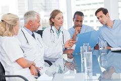 Medical team examining a file Royalty Free Stock Photo