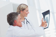 Medical team examining a radiography Royalty Free Stock Images