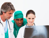 Medical team examining an x-ray Stock Image