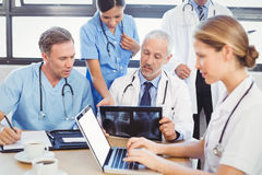 Medical team examining a x report. In conference room Stock Photography
