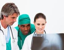 Medical team examining an x-ray Stock Image