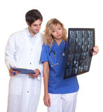 Medical team examining a x-ray Royalty Free Stock Photo