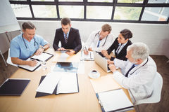 Medical team having a meeting in conference room Stock Images
