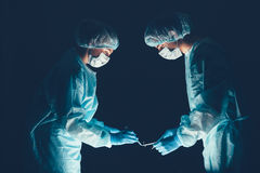 Medical team  hospital performing operation. Group of surgeon at work in operating theatre room. healthcare . Royalty Free Stock Photography