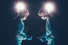 Medical team  hospital performing operation. Group of surgeon at work in operating theatre room. healthcare . Royalty Free Stock Image