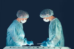 Medical team  hospital performing operation. Group of surgeon at work in operating theatre room. healthcare . Royalty Free Stock Images