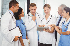 Medical team interacting and using digital tablet. In hospital Royalty Free Stock Images