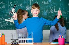 Medical team. Little children at school lesson. Little kids learning chemistry in school lab. happy childrens day royalty free stock photos