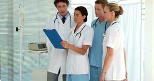 Medical team looking at clipboard