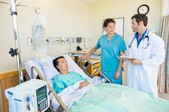 Medical Team Looking At Each Other While Patient stock photos