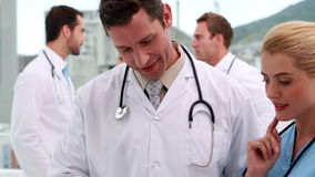 Medical team looking at file together