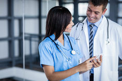 Medical team looking at phone together Royalty Free Stock Photography