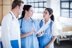 Medical team looking at tablet pc. In the hallway Stock Photo