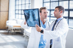 Medical team looking at x-ray together Stock Image