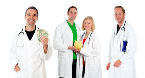 Medical team with money, book and piggy bank Royalty Free Stock Image