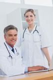 Medical team in the office at desk Royalty Free Stock Image