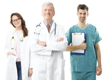 Medical team. Old male doctor with his medical team standing against white background Stock Photo