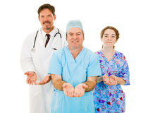 Medical Team - Open Handed. Medical team holding their hands open indicating caring and acceptance.  Isolated on white Royalty Free Stock Photography