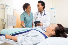Medical Team And Patient In Hospital Room Stock Photo