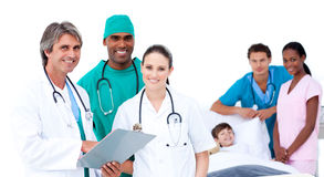 Medical team in a patient's bedroom Royalty Free Stock Images
