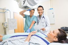 Medical Team With Patient In Xray Room Stock Images