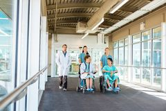 Medical Team With Patients On Wheelchairs At Stock Photography