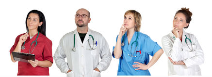 Medical team with pensive gesture Royalty Free Stock Photos