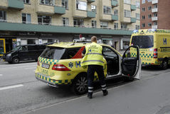 MEDICAL TEAM AND POLICE IN ACTION Stock Photo
