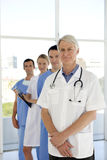 Medical team. Portrait of a medical team with senior leader Stock Image