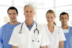 Medical team. Portrait of a medical team with senior leader Royalty Free Stock Photography
