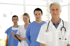 Medical team. Portrait of a medical team with senior leader Royalty Free Stock Photo