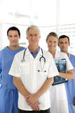 Medical team. Portrait of a medical team with senior leader Royalty Free Stock Photos