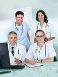 Medical team posing in an office Stock Photography