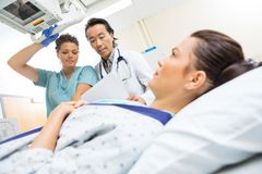 Medical Team Preparing Patient For Xray Stock Photography