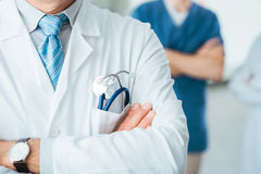 Medical team. Professional medical team posing, doctor's lab coat and stethoscope close up, selective focus royalty free stock photos