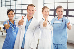 Medical team putting their thumbs up and smiling Stock Images