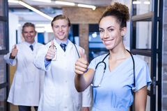 Medical team putting their thumbs up and smiling Royalty Free Stock Photos