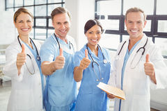 Medical team putting their thumbs up and smiling Stock Photo