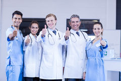 Medical team putting thumb up and smiling Royalty Free Stock Photos