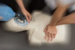 Medical team resuscitate a patient in a hospital Stock Image