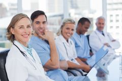 Medical team in row. Looking at the camera stock photo