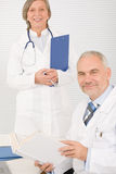 Medical team senior doctor with colleague stock images