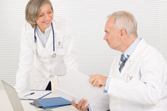 Medical team senior doctor with work colleague Stock Image