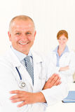 Medical team senior smiling male young woman Stock Image