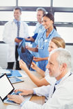 Medical team smiling in conference room. In hospital Stock Images