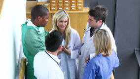 Medical team speaking in the stairs of a hospital footage stock footage