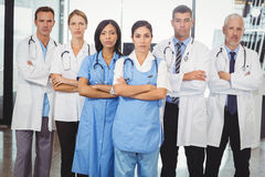Medical team standing with arms crossed Stock Images
