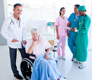 Medical team taking care of a senior woman Royalty Free Stock Photo