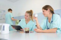 Medical team taking coffee break stock image
